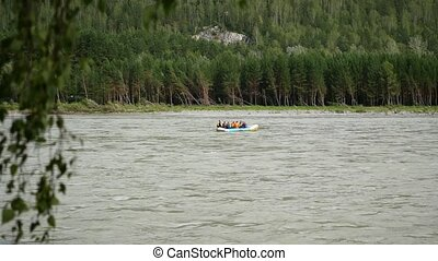 people rafting on a mountain river on a boat