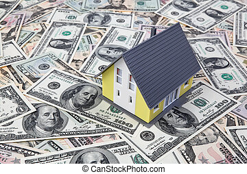 House on dollar bills - A house stands on many U.S. dollars...