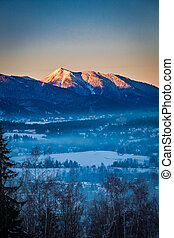 Sunrise in Zakopane with illuminated peak in winter, Tatra...