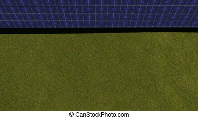 Solar panels on a green field. View from above