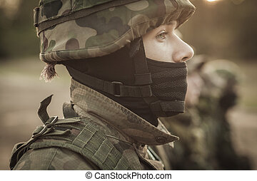 Waiting for the orders - Close shot of young soldier face in...