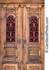 Double Door - Double wooden door detail with red decorative...