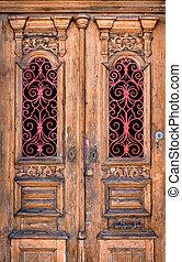 Double Door - Double wooden door detail with red decorative...