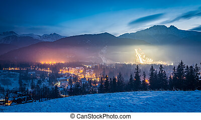 Zakopane during the skiing competitions at dusk in winter,...