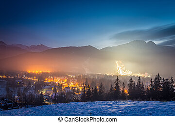 Skiing competitions in Zakopane in winter at dusk, Poland