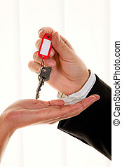 Real estate broker with a house key