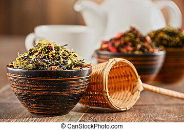 Composition with bowls of tea leaves.