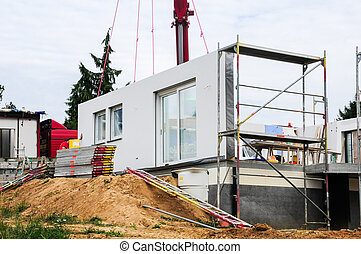 Assembly of prefabricated house - Mounting a house wall on a...