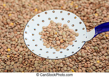 Metallic old spoon on lentils background - Metallic old...