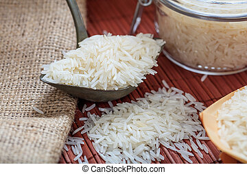 Jasmine rice in a metallic old spoon - Jasmine rice and...