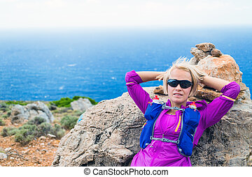 Happy woman runner hiker relaxing - Trail running woman...