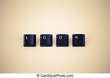 look word written with black computer buttons over white -...
