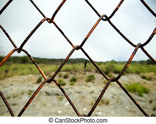 Old iron wire fence
