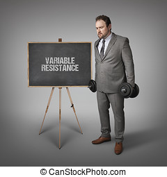 Variable resistance text on blackboard with businesssman...