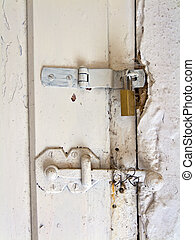 An old door hinge of a House - Old hinge of a door of a...