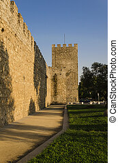 wall surrounding evora - view of the middle ages wall that...