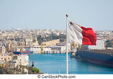 Maltese flag - View of a Maltese flag waving.