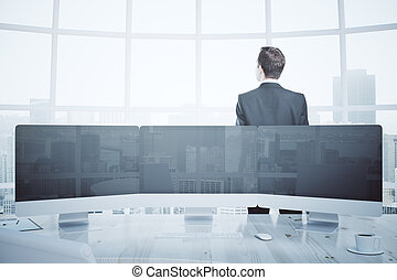 Businessman and digital panel - Thoughtful businessman in...