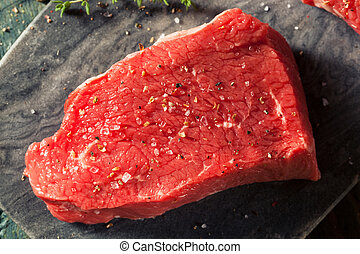 Raw Organic Grass Fed Sirloin Steak with Salt and Pepper