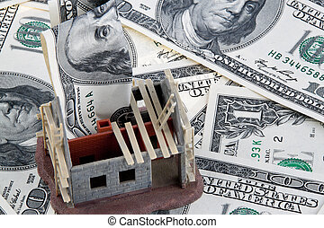 House construction site Funding with dollar bills - A shell...