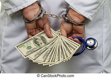 Doctor with dollar bills and handcuffed - A doctor with...