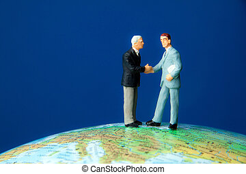 Two managers on a globe. Globalization
