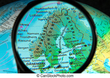 Scandinavia seen through the magnifying glass on a globe