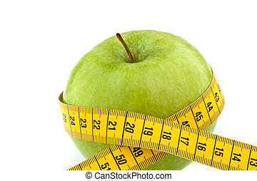 Apple with measuring tape. Symbol of diet with fruit