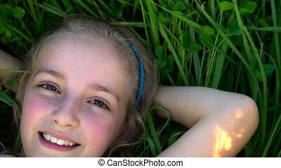 cute girl on grass