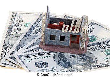 House construction site. Funding with dollar bills - A shell...