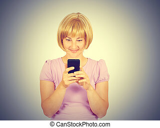 Young woman reading good news on the phone.