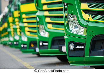 transporting freighting service lorry trucks in row -...