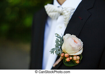 rose on suit jacket of groom - on his jacket men hitched...
