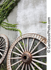 Wooden wheel on old brick wall - Wooden wheel on the...