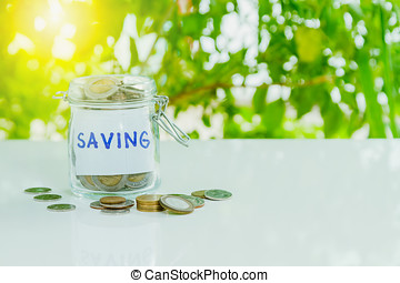 Money in the glass with filter effect retro vintage style,Coins in jar with saving, retirement and emergency plan label - financial concept,business background,money content and selective focus.