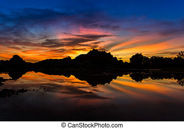 Twilight sky after sunset over the lake - Silhouette of...