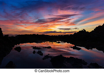 Twilight sky after sunset over the lake. - Silhouette of...