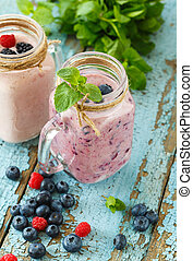 Well being and weight loss concept, berry smoothie on wooden...