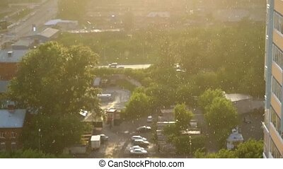 Its rainy on a background of the city at sunset in...