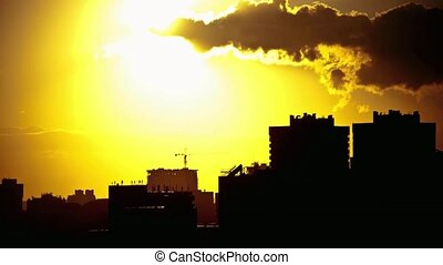 Sunset over downtown city skyline on silhouette of architecture