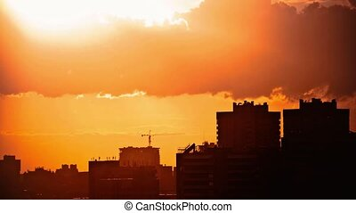 Sunset over downtown city skyline on silhouette of...