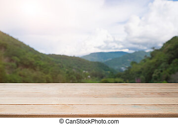 Wooden table. Spring design with pine forest and empty display.