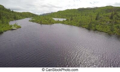 Aerial view of freshwater lake in the mountain - Flying over...