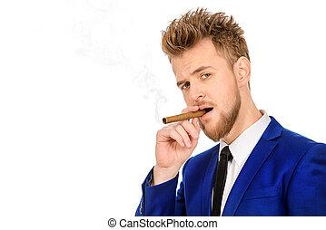 man smokes a cigar - Handsome man smoking a cigar. Men's...