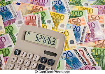 Euro banknotes with calculator