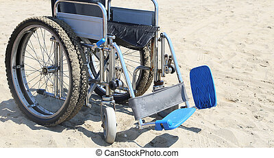 Wheelchair on the beach in summer - Wheelchair on the hot...