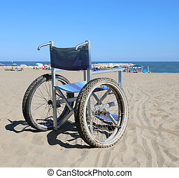 wheelchair on the sand beach near the sea - Modern...