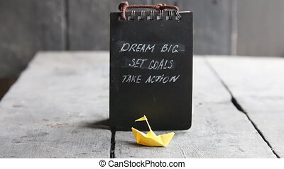 Dream Big - Set Goal - Take Action, handwriting on notebook...