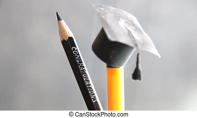 congratulations graduates background, inscription in pencil...