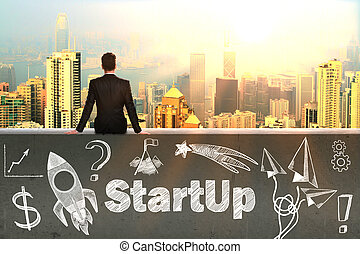Start up concept with sitting businessman looking at...
